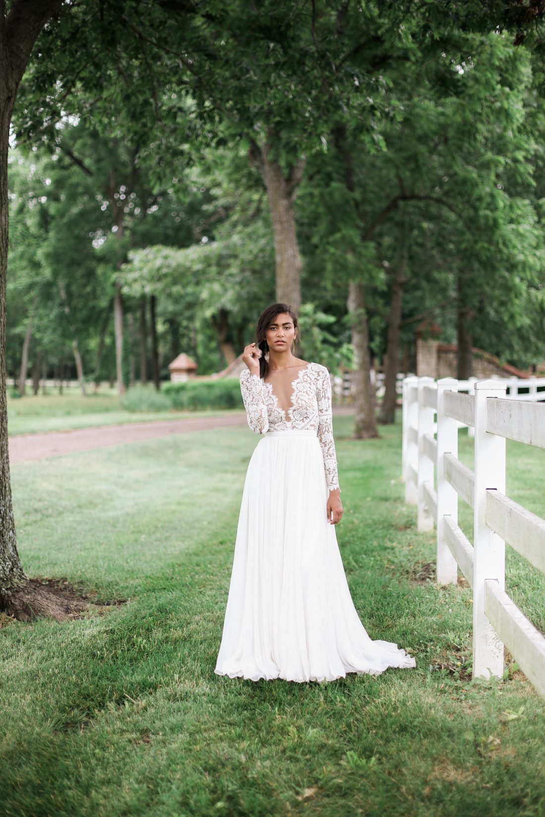 Mildale Farms Kansas City Wedding bride by fence