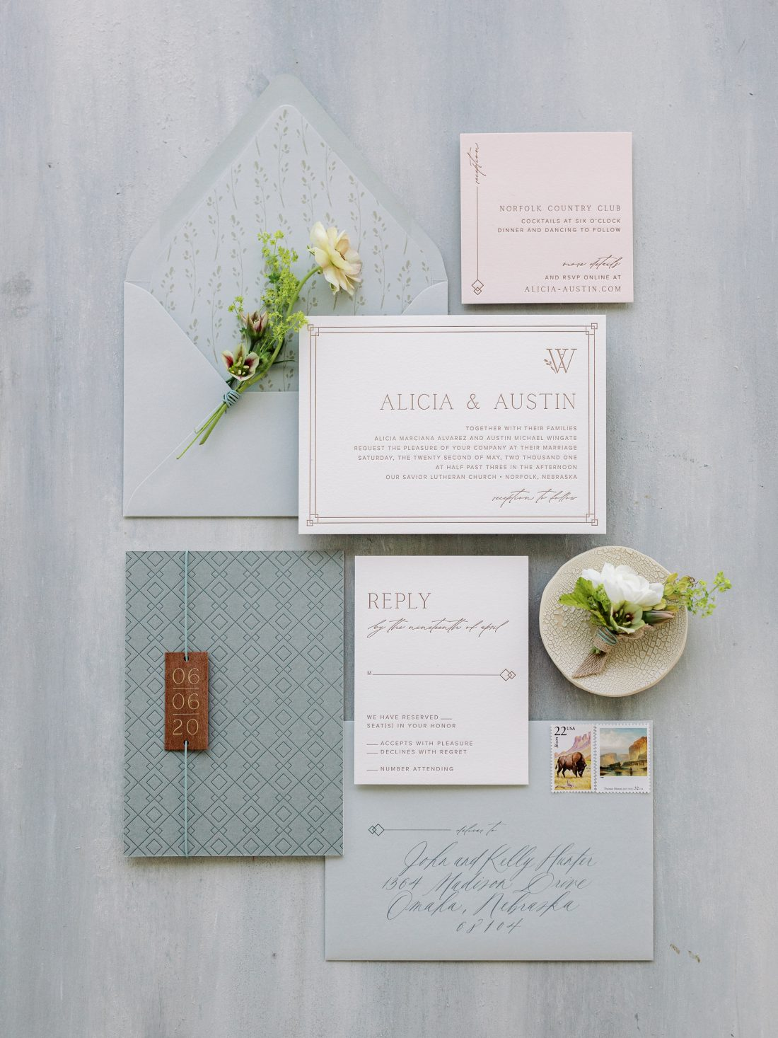 The letterpress invitations were pressed into a suede-textured paper. The warmth of the rust-colored ink provided a nice contrast to the blue duplexed paper and envelopes.